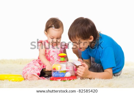 portrait of a two children playing on carpet