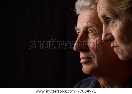 portrait of a two people looking at something