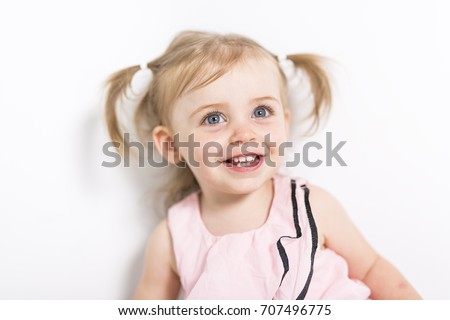 Portrait of a two year old girl isolated on white background