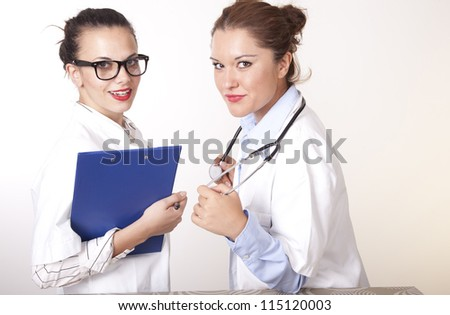 Portrait of a two young beautiful female doctors.