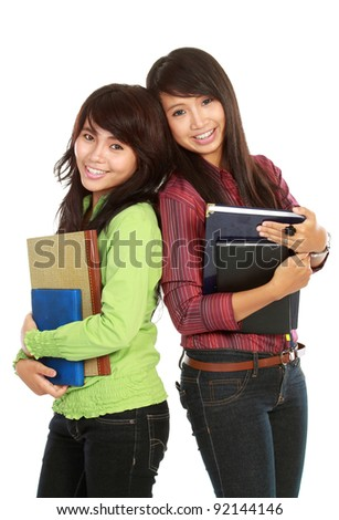 Portrait of a two young students holding a book isolated on white background