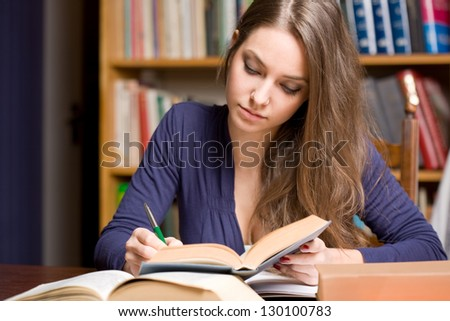 Portrait of a very busy young brunette student.