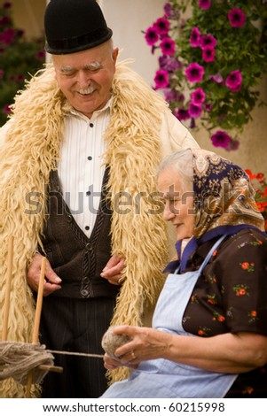 Portrait of a very old couple at country side smiling and having fun. See more images with them.