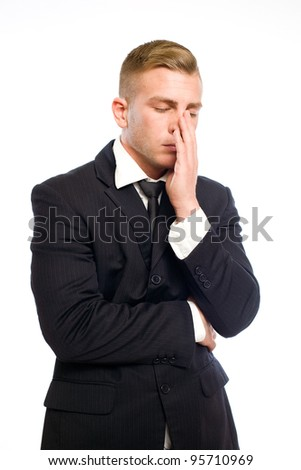Portrait of a very tired looking elegant young businessman. - stock photo