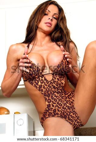 Portrait of a voluptuous woman in animal print bikini