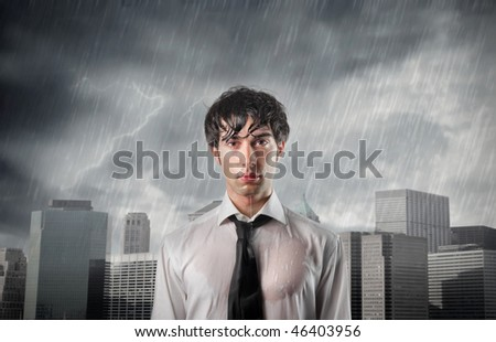 Portrait of a wet businessman with cityscape on the background