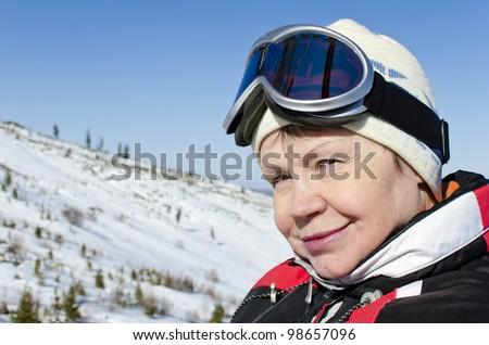 Portrait of a woman alpine skier in the lift