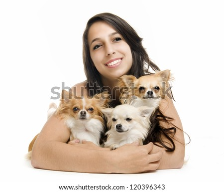 portrait of a woman and three chihuahuas in front of white background