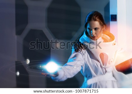 Portrait of a woman astronaut in a space suit, dreamy look up #1007871715