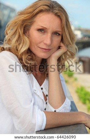 Portrait of a woman at the sea - stock photo