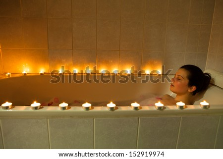 portrait of a woman bathing in...