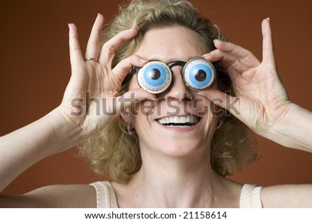 portrait of a woman clowning and wearing novelty eyeglasses