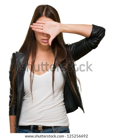 Portrait of a Woman Covering Her Eyes On White Background - stock photo