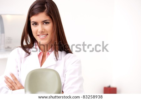 Portrait of a woman dentis smiling looking at the camera