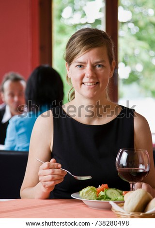 portrait of a woman eating a...