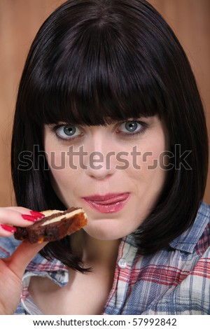 Portrait of a woman eating cake