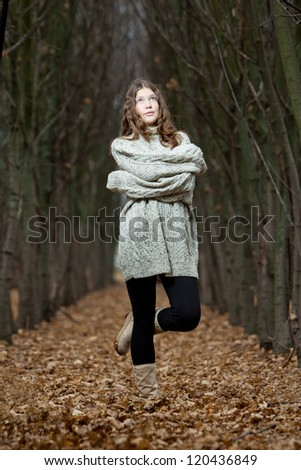 Portrait of a woman feeling cold in winter. Girl wearing knitted warm clothing waiting for snow - stock photo