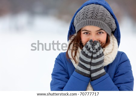 Portrait of a woman feeling cold in winter ? outdoors #70777717