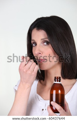 Portrait of a woman healing with a syrup
