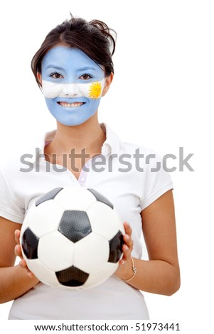 Portrait of a woman holding a soccer ball with the argentinian flag painted on her face - Isolated over a white background - stock photo