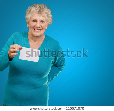 Portrait Of A Woman Holding Blank Paper On Blue Background