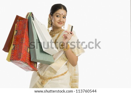 Portrait of a woman holding shopping bags with a credit card