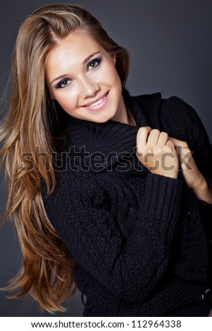 Portrait of a woman in a winter sweater