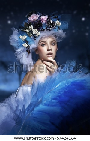 Stock Photo Portrait of a woman in hat made of flowers