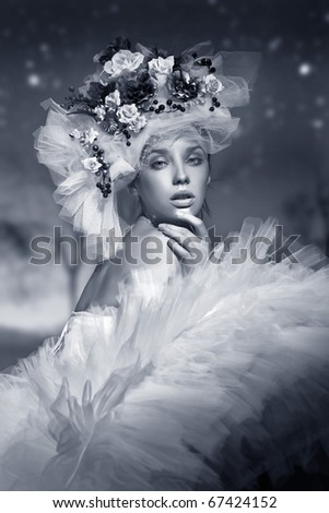 Portrait of a woman in hat made of flowers in black and white
