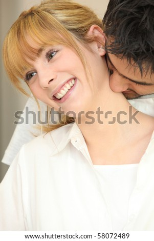 Portrait of a woman in the arms of a man