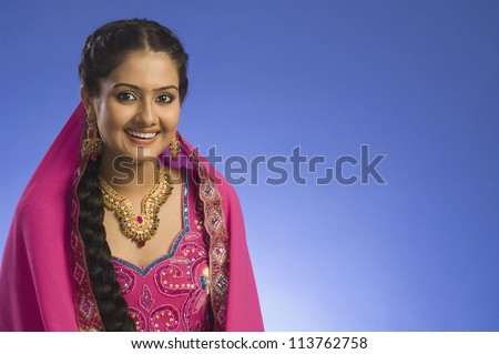 Portrait of a woman in traditional dress and smiling
