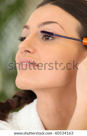 Portrait of a woman making up