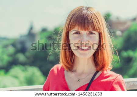Portrait of a woman. Portrait of a woman against the background of a green bush.