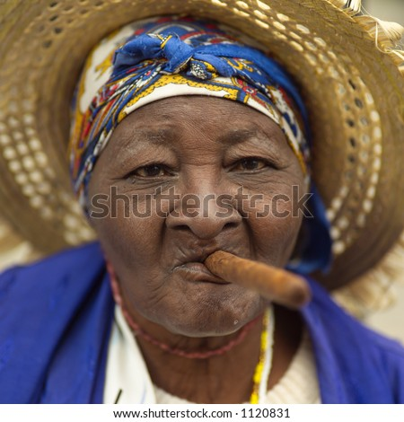 stock-photo-portrait-of-a-woman-smoking-a-cigar-havana-cuba-1120831 - The pleasure of cigar smoking - Lifestyle, Culture and Arts