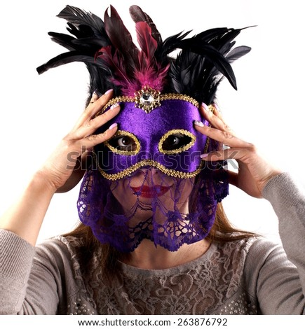 Portrait of a woman wearing a carnival mask