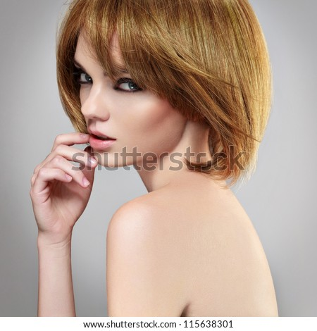 Portrait of a woman with a bob hairstyle.