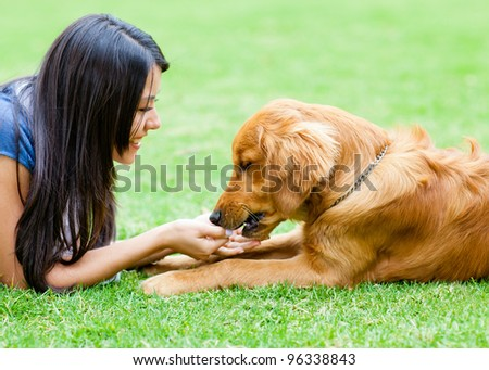 Portrait of a woman with a dog at the park