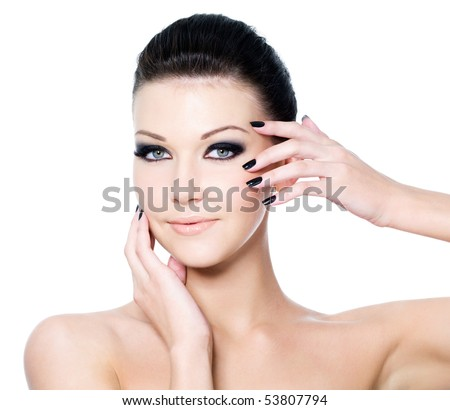 Portrait of a woman with Beautiful black eye make-up and beauty manicure