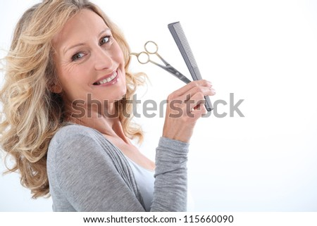 portrait of a woman with comb and scissors
