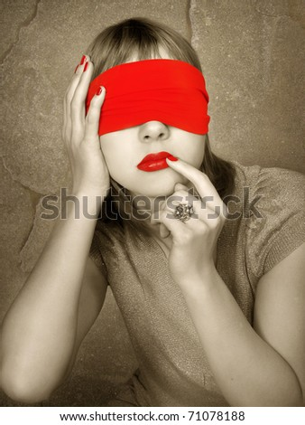 Portrait of a woman with covered eyes. Red lips and manicure