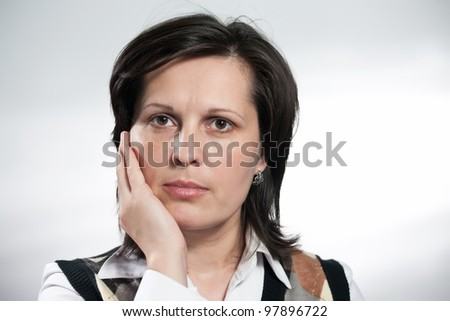 Portrait of a woman with emotions on white background