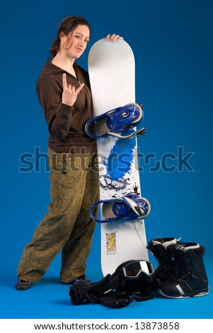 Portrait of a woman with long curly hair with snowboard making the hang loose sign