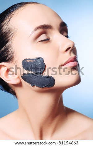 Portrait of a woman with spa mud mask on her face.