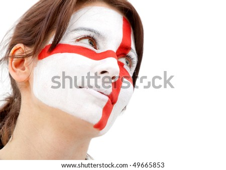 Portrait of a woman with the english flag paited on her face - over a white background