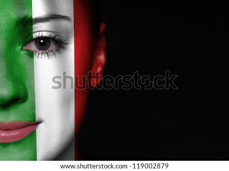 Portrait of a woman with the flag of the Italy painted on her face