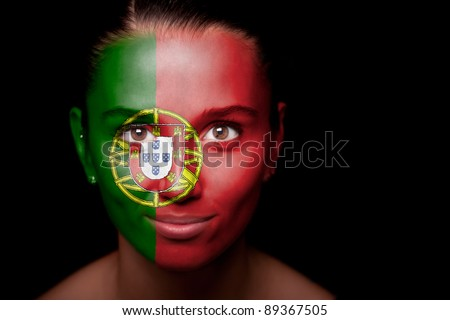 Portrait of a woman with the flag of the Portugal painted on her face.