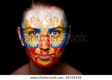 Portrait of a woman with the flag of the Russia painted on her face.