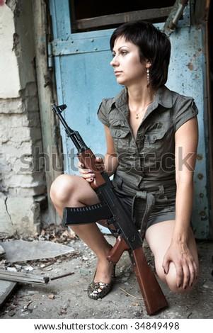 Portrait of a woman with the Kalashnikov machine gun.
