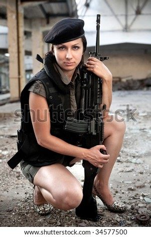 Portrait of a woman with the machine gun.