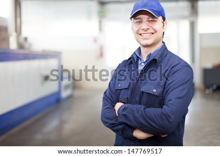 Portrait Of A Worker In A Factory